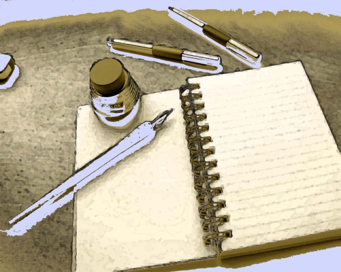 Table with notebook and gold pens